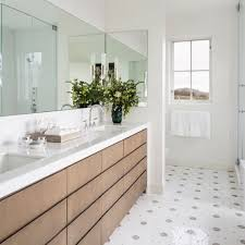 mid sized trendy master porcelain floor alcove shower photo in santa barbara with flat