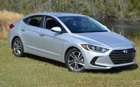 2017 hyundai elantra silver. those are mini-air dams that hyundai says helps airflow around the nose, but also nicely accent face. hood line is higher, paired with flatter 2017 elantra silver
