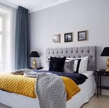 cozy blue black bedroom. grey and blue decor with yello pop of color bedroom inspiration cozy black e