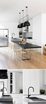 in this modern kitchen white cabinets brighten the room the matte black lighting and