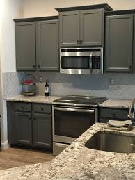 Remodeled Kitchen Painted Cabinets For An Inexpensive Fix To Builder Grade Cabinets Slide In Stove G Glass Tile Backsplash Kitchen Tile Backsplash Backsplash