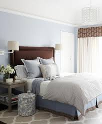 brown and blue bedroom with gray nightstands and gray trellis rug