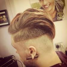 a 2 step undercut hairstyle done by a barber