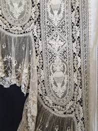 superb needlepoint lace curtains w urns mythological animals brussels lace a stunning and rare pair of shaped curtains that possibly came from the lace