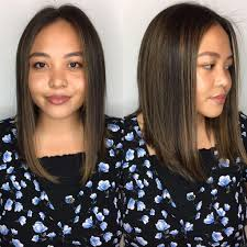 Womens Sleek Angled Lob With Center Part And Caramel Highlights On
