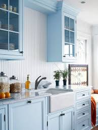 narrow white beadboard looks very delicate with light blue cabinets