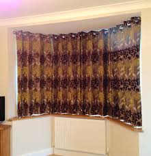can you put eyelet curtains on a bay window pole gopellingnet