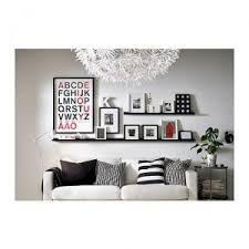 i love the clean black and white look in this image with the pops of red even simple ikea frames and shelves can look so put together  on wall art shelf with wall art inspiration confessions of a prop junkie