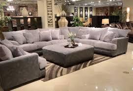 gray sectional sofa with nailhead trim