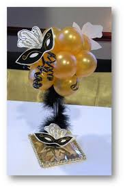 Table Decorations For Masquerade Ball Another centerpiece idea for a masquerade themed party Stylish 100
