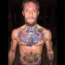 Conor Mcgregors Chest Tattoo Of A Gorilla King Eating