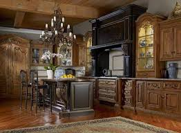 old world kitchen decor wrought iron chandelier and ceramics and cabinets