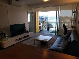 a television and or entertainment centre at 2 bed modern inner city apt riverside