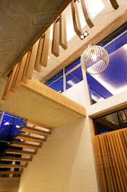 modern pendant light and stairs in luxury foyer