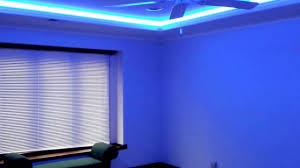 tray ceiling with led multi colored lighting behind crown molding you