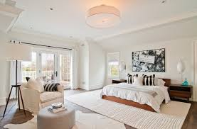 white carpet bedroom. transitional dark wood floor bedroom photo in new york with white walls carpet a