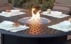 fire pit in the center of the outdoor table