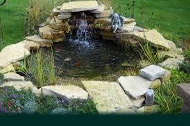 Small Backyard Koi Pond Design With Stone Border And Waterfall Small Backyard Pond Waterfalls Ideas