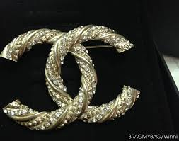 chanel earrings price. chanel-brooch chanel earrings price
