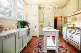 galley kitchen with island at end. narrow kitchen island for galley design with chandelier lighting fixture at end
