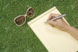 people writing on the paper over green grass you can write your people writing on the paper over green grass you can write your message on the