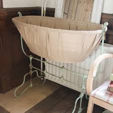 antique cast iron rocking baby bed