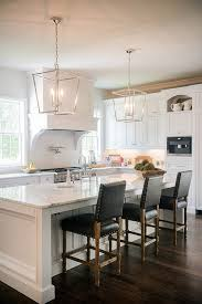 lighting kitchen island. stunning white kitchen with silver lanterns and dark leather barstools lighting island