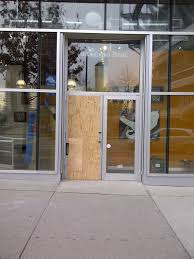 broken front entry aluminum door due to burglary this commercial aluminum glass entry door needs to be custom manufactured therefore a temporary