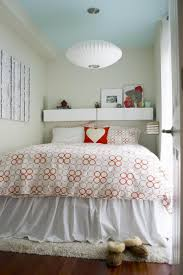 awesome very small scandinavian bedroom with wall to bed cabinet circle pattern bedcover modern lampion lamp ideas bedroom furniture interior fascinating wall