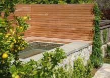 ... at 15 privacy fence ideas that reflect a range of materials and styles.  Yet all of them work well in yards and gardens with a modern aesthetic.