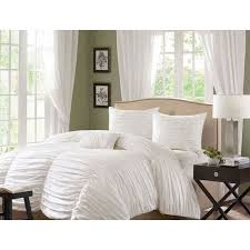 eye catching style meets comfort in the madison park catalina cotton duvet cover set the duvet cover features a cotton face with a soft cotton reverse