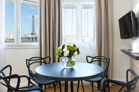 dining with eiffel tower view. citadines tour eiffel paris: 1-bedroom apartment with tower view, dining view