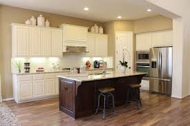 burrows cabinets kitchen in knotty alder with verona finish and appliance end panels