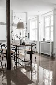 the wooden table is by nordal and the chairs are trered vine thonet pieces photography peter kragballe styling camilla tange peylecke