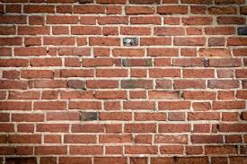 old brick wall under construction