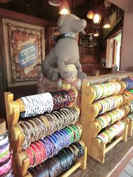 personalized leather souvenirs are offered for in frontierland photo by adrienne vincent phoenix