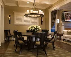 round dining room table images. traditional dark wood floor and brown dining room idea in chicago with beige walls round table images