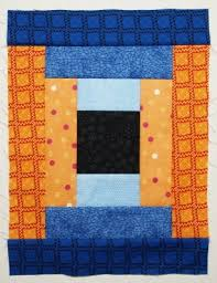 How To Make Courthouse Steps Log Cabin Quilt Block | Quilts By Jen & Sew the dark blue pieces to the unit from step 4 Adamdwight.com