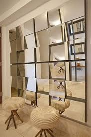 Small Picture A geometric mirrored wall conceals closets and storage spaces