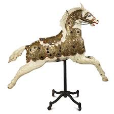 antique wooden carousel horse with rare brass jewel trimmed armor and saddle