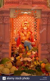 idol lord ganesh decoration fruits flowers worship ganapati