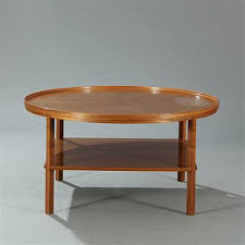 circular coffee table with underlying shelf model 6687 by kaare klint