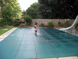 safety pool covers. Pool With Safety Cover And Child Running Across No Concerns Covers