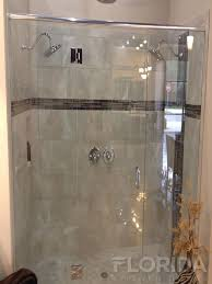 glass to glass frameless shower enclosure with euro header glass clamps secure panels