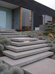 Diy concrete step Stone Cantilevering Entry Steps With Ornamental Grass Outdoor Spaces Noahseclecticcom Concrete Front Steps Design Ideas Noahseclecticcom