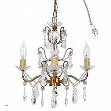 crystal chandelier lights up the paintings on the wall new madeleine vintage gold crystal chandelier mini