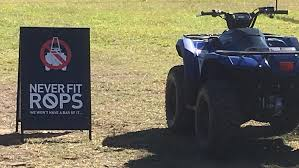 yamaha quad bike. atv safety: an anti-rollover protection system sign at the yamaha launch in quad bike