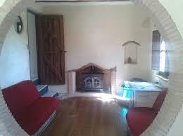 red sofa warm oak floor