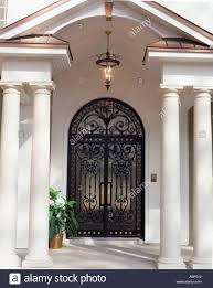 wrought iron front doorsCustom wrought iron front doors installed on residential home