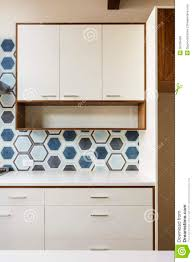 Blue Tiles For Kitchen White Kitchen Cabinet In Modern Home With Blue Tile Royalty Free